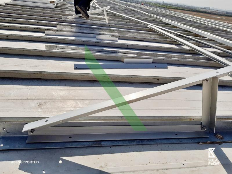 Fixed tilt flat roof mount, Fixed angle flat roof mounting system, Triangle mounting system on concrete base, Triangle mounting structure on concrete base, flat roof racking, flat roof mounting system, triangle fixed tilt option, triangle fold design, Fixed tilt triangle, triangle on concrete foundation